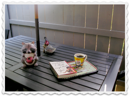 may 27 patio reading with coffee